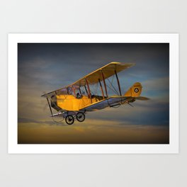 Yellow Biplane with Sunset Cloudy Sky Art Print