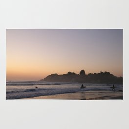 Surfers at Sunset Rug