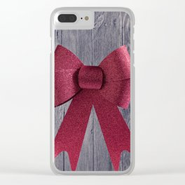 Big red Christmas shiny bow on a wooden background Clear iPhone Case