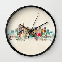 north carolina Wall Clocks featuring charlotte city north carolina by bri.buckley