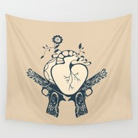 guns Wall Tapestries featuring 2 guns and one heart by olillia