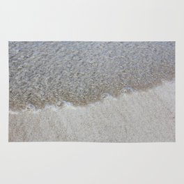 Small waves rolling in Rug