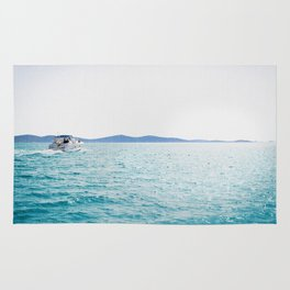 Boat And Turquoise Ocean Rug
