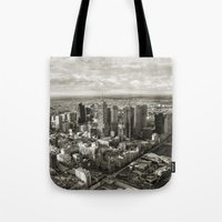 melbourne Tote Bags featuring Melbourne City by Ewan Arnolda