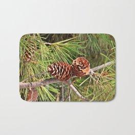 Pinecone on pine tree Bath Mat