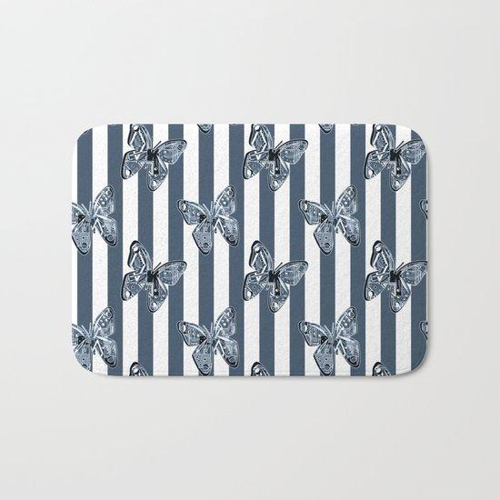 Blue butterflies on a striped background . Bath Mat