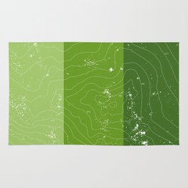 Green topographic map of a mountain Rug