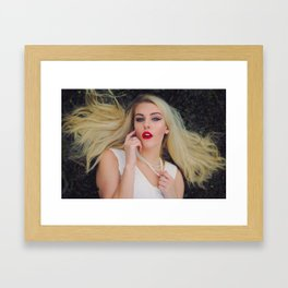 A Woman in White Framed Art Print