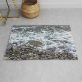 Wave washing over pebbles Rug