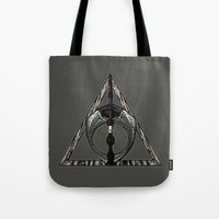 deathly hallows Tote Bags featuring Master of Death by Talesanura