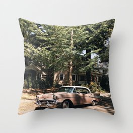 VINTAGE PINK SEDAN PARKED IN FRONT OF TREE Throw Pillow