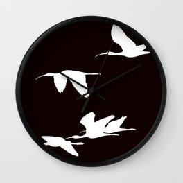 White Silhouette of Glossy Ibises In Flight Wall Clock