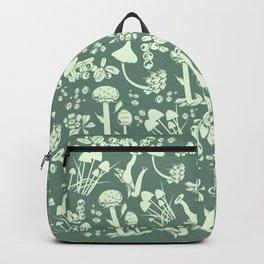 White mushrooms on green background Backpack