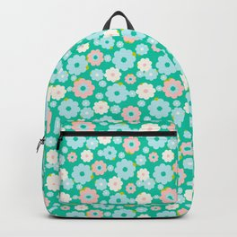 Small blue, white and pink flowers over a turquoise background Backpack