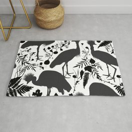 Black crowned crane with grass and flowers black silhouette Rug