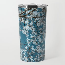 Beautiful white flowers all over the trees with clear blue sky in the background Travel Mug