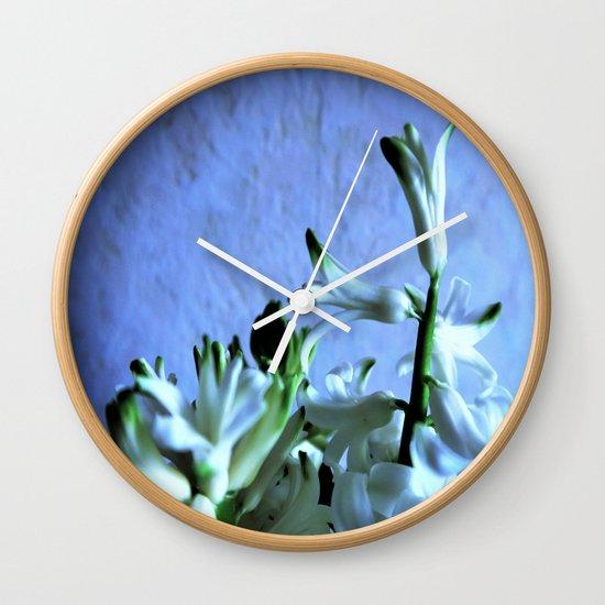 white hyacinthe on light blue background Wall Clock