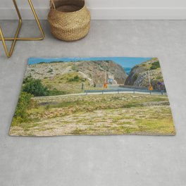 Landscape with mountain and road in Krk island, Croatia Rug