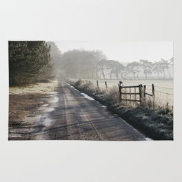 Remote frozen country road a t sunrise. Norfolk, UK. Rug