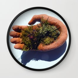 bush in the hand Wall Clock