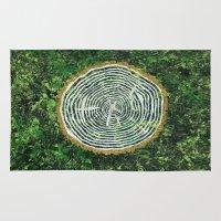 tree rings Area & Throw Rugs featuring Tree Rings by Zoë Miller