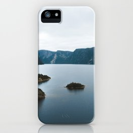 Overlooking cliffs on the edge of a lake iPhone Case