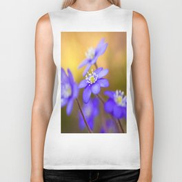 Spring Wildflowers, Beautiful Hepatica in the forest on a sunny and colorful background Biker Tank