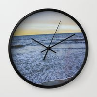 rileigh smirl Wall Clocks featuring Ocean Sunset by Rileigh Smirl