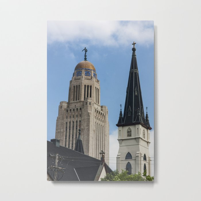 spires of lincoln nebraska, the spires of the state capitol building and Saint Marys Catholic Church Metal Print