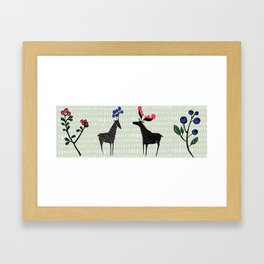Berry loving deers on a green background Framed Art Print