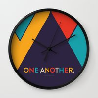 scripture Wall Clocks featuring One Another Scripture Poster (Galatians 12) by Jess Creatives