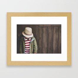 Little boy on wooden background Framed Art Print