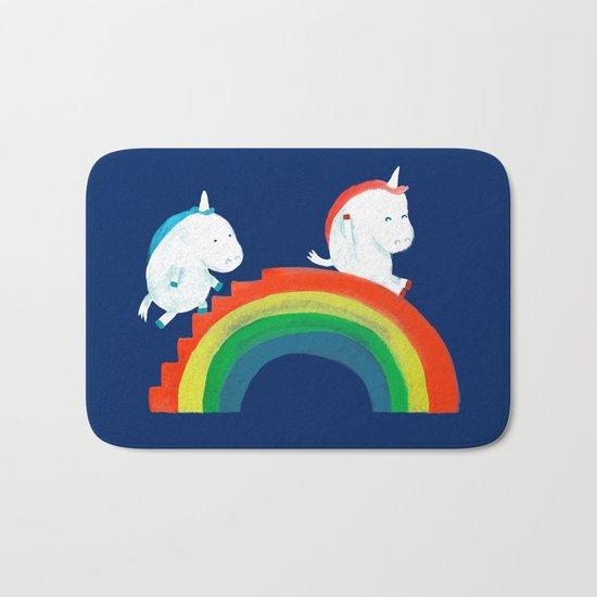 Unicorn on rainbow slide Bath Mat