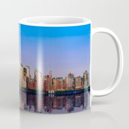 Reflection of Manhattan skyline at sunset Coffee Mug