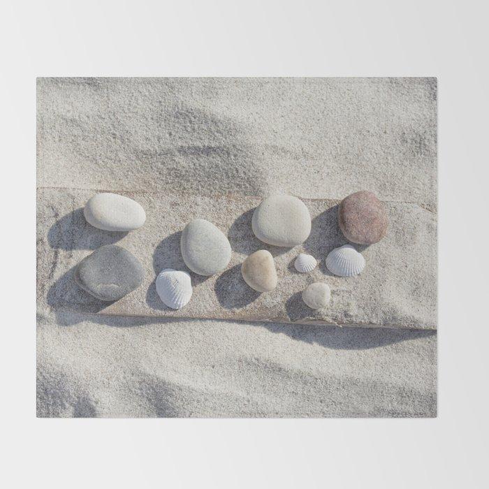 Beach pebble driftwood still life Throw Blanket
