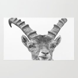 Black and white capricorn animal portrait Rug