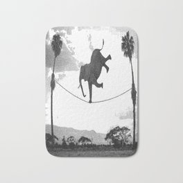 The elephant on the tightrope Bath Mat