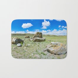 Tarkhatinsky megalithic complex. Steppe and blue mountains on the horizon. Altai Russia. Bath Mat
