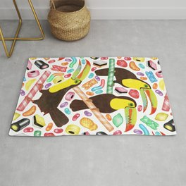 Toucandy - rainbow sweets and licorice surround tropical toucans on candy canes Rug