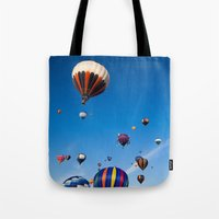 hot air balloons Tote Bags featuring Vibrant Hot Air Balloons by Nicolas Raymond
