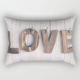 The word 'love' in wooden letters on a rustic background Rectangular Pillow