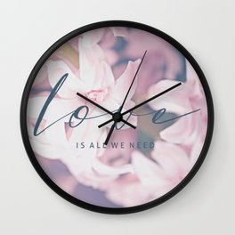 LOVE IS ALL WE NEED. TYPO ON FLORAL IMAGE Wall Clock
