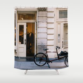 Old bicycle parked at luxury fashion store in New York Shower Curtain