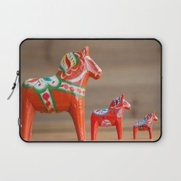 Three Dala horses in decreasing sizes in a row Laptop Sleeve