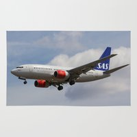 scandinavian Area & Throw Rugs featuring Scandinavian Airlines Boeing 737 by David Pyatt