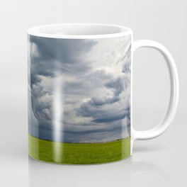 Supercell storm clouds above meadow with green grass Summer Storm clouds Coffee Mug