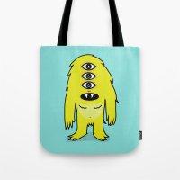 sasquatch Tote Bags featuring Alien Sasquatch by Zak Rutledge