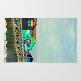 Small colorful Houses at Sea Rug