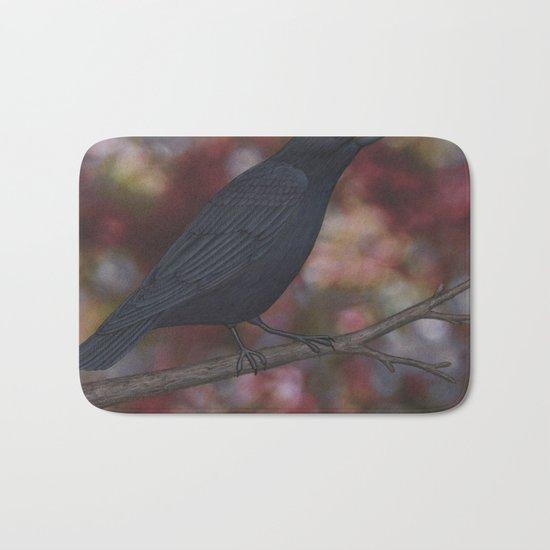 crow on a branch bokeh Bath Mat
