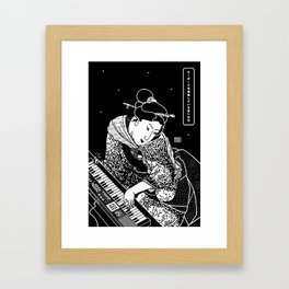 Young woman playing a keyboard Framed Art Print